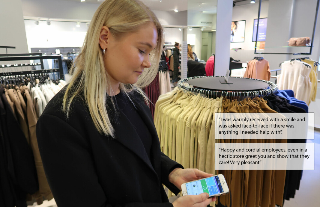 The shop manager continuously receives feedback from customers on their mobile phone app.